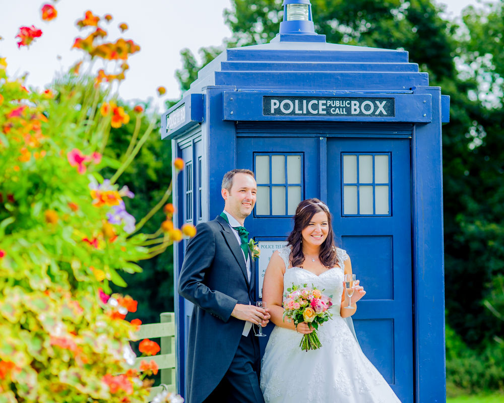 Bride and groom in front of tardis