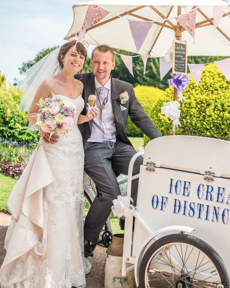 Ice cream cart at wedding with bride and groom
