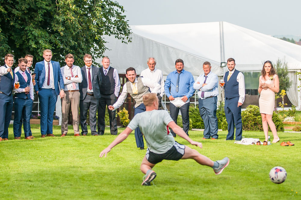 Penalty shoot out at Ringwood Hall hotel grounds, Sheffield wedding photographers
