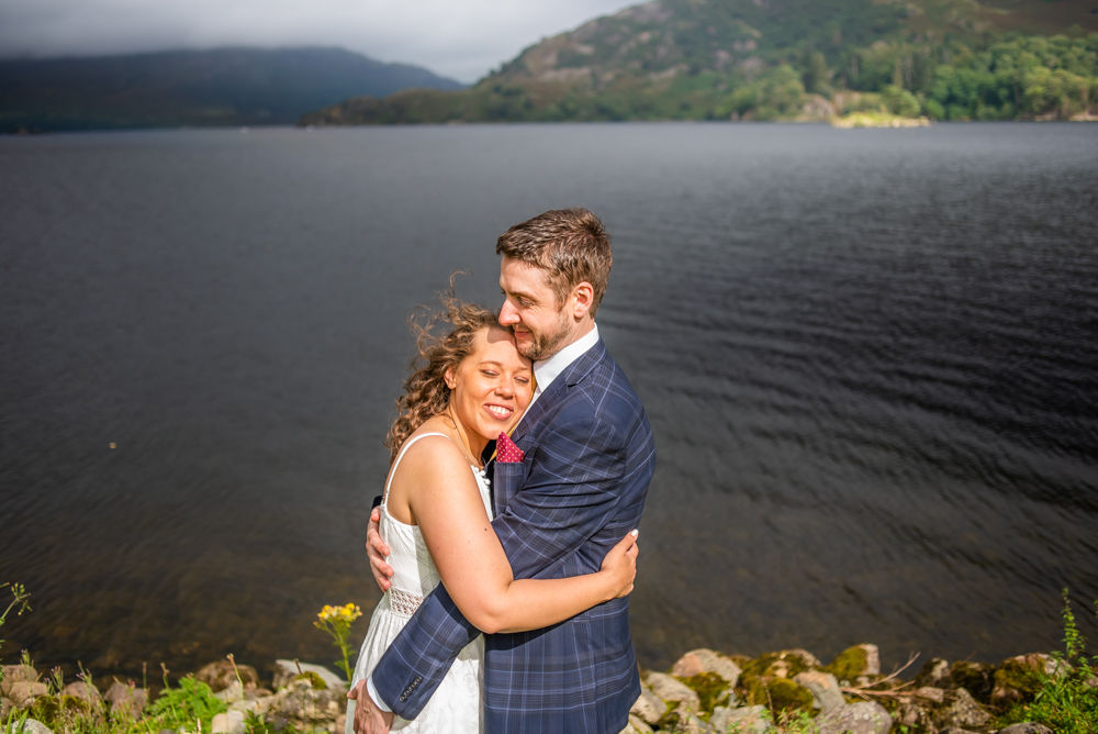 Cuddles by the lake, Glenridding House elopement wedding, Ullswater