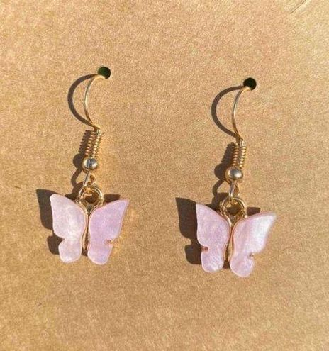 Urban Outfitters pink butterfly earrings