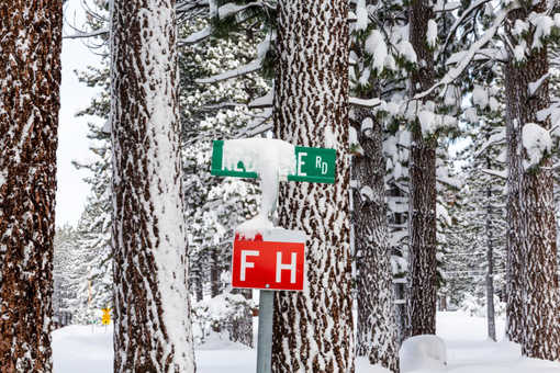 road signs covered snow winter