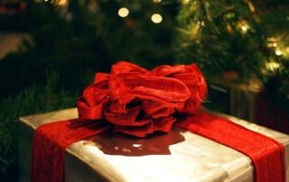 Holiday Gift wrapped with a red bow