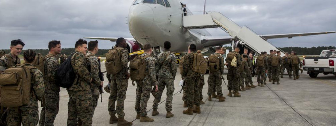 US Marines with the II Marine Expeditionary Force, one of the contingents that took part in Trident Juncture 18, board a Boeng 767-200ER aircraft, Cherry Point, North Carolina, 19 October 2018. Courtesy of US Marine Corps.