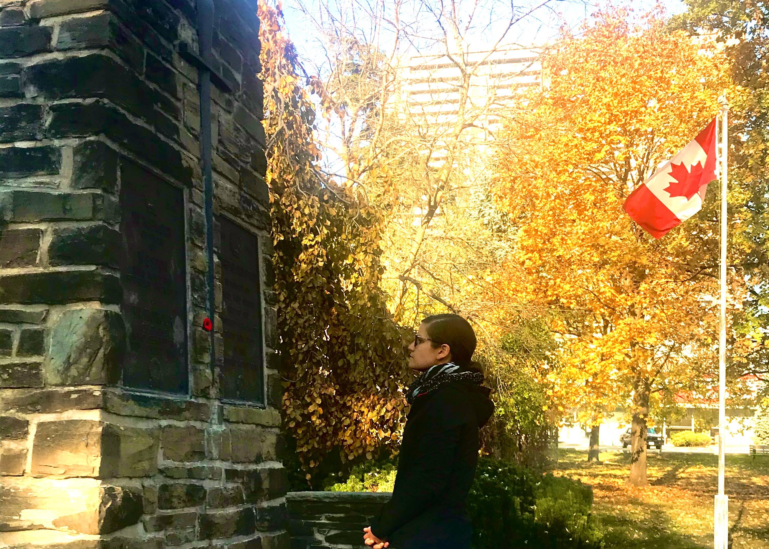 Chiara Padovani stands at the Weston Cenotaph