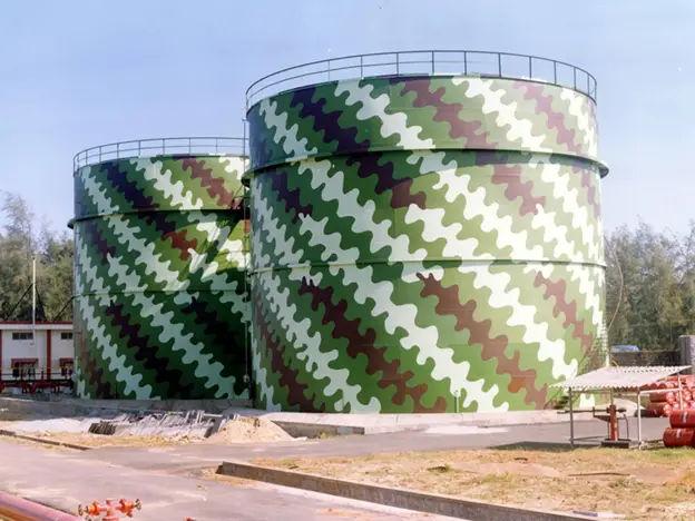Camouflaged oil storage tanks