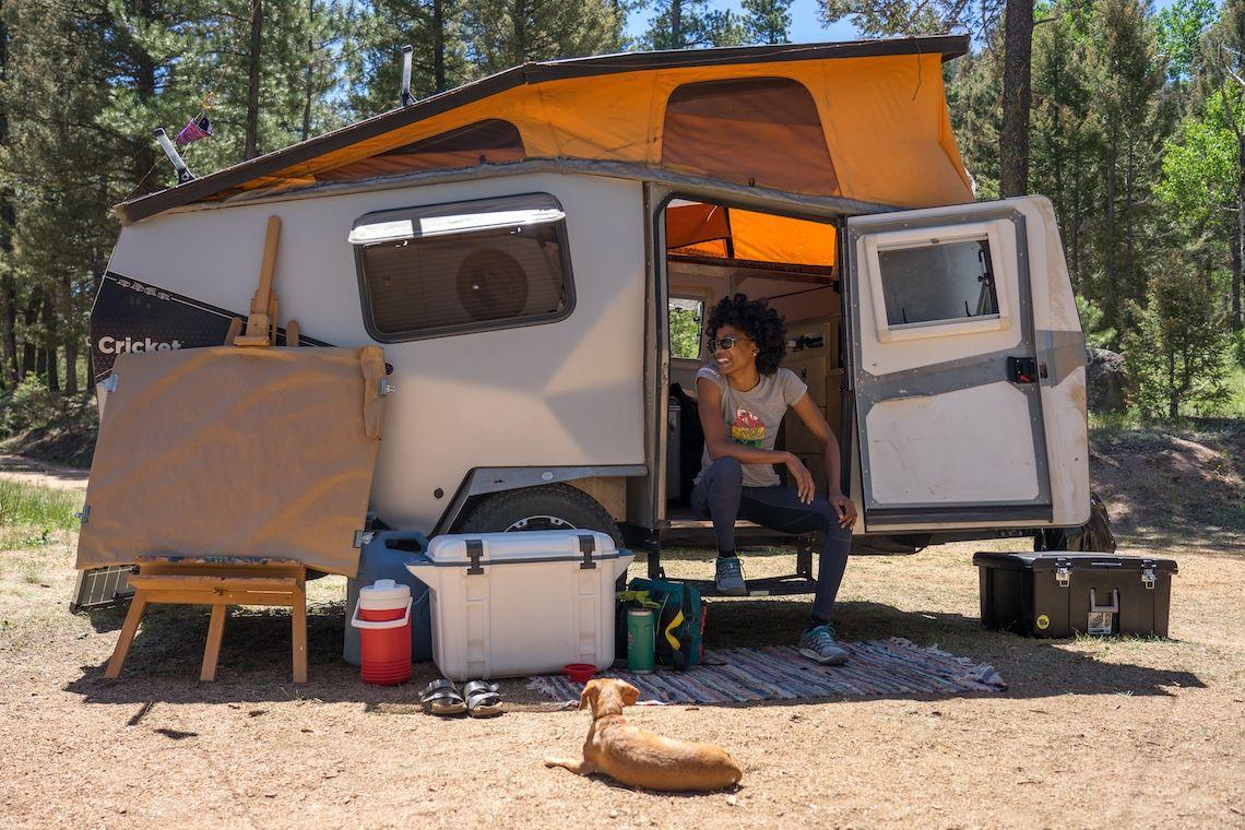 Latasha Dunston outside of her RV at Wellington Lake, CO