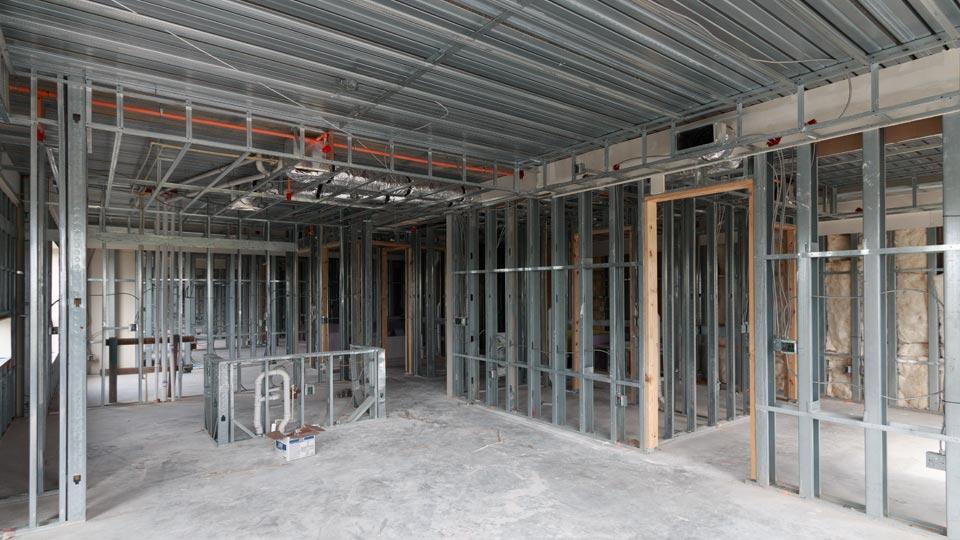 Metal stud wall construction supporting Versa-Dek composite