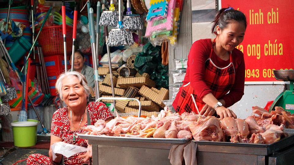 A market vendor selling various meats