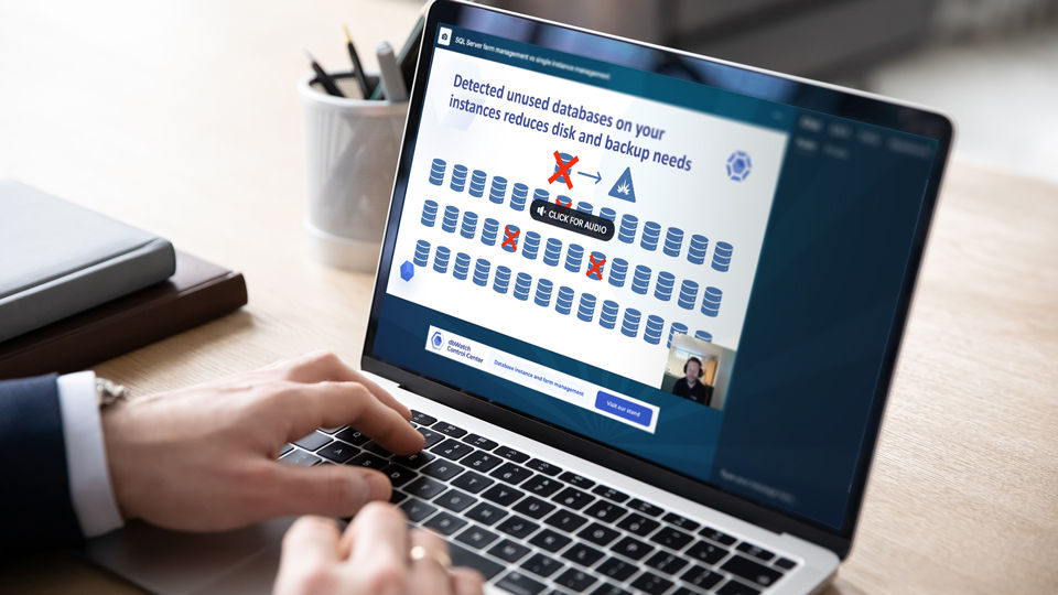 A person sitting down drinking coffee, looking at a laptop with the ServiceNow website on the screen