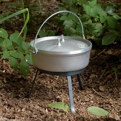 The Ray Mears Folding Trivet, in use with a dutch oven