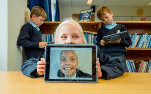 prep children laugh smile ipad