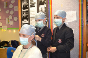 teacher dressed as surgeon