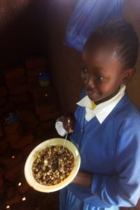 Kenyan girl with lunch