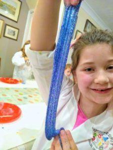 girl holding glittery silme