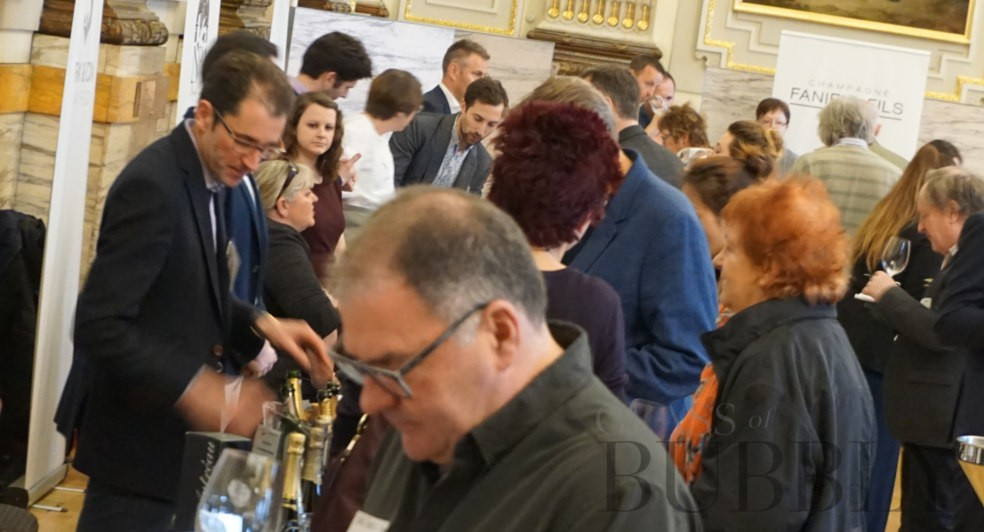 glass of bubbly tasting crowds 2019