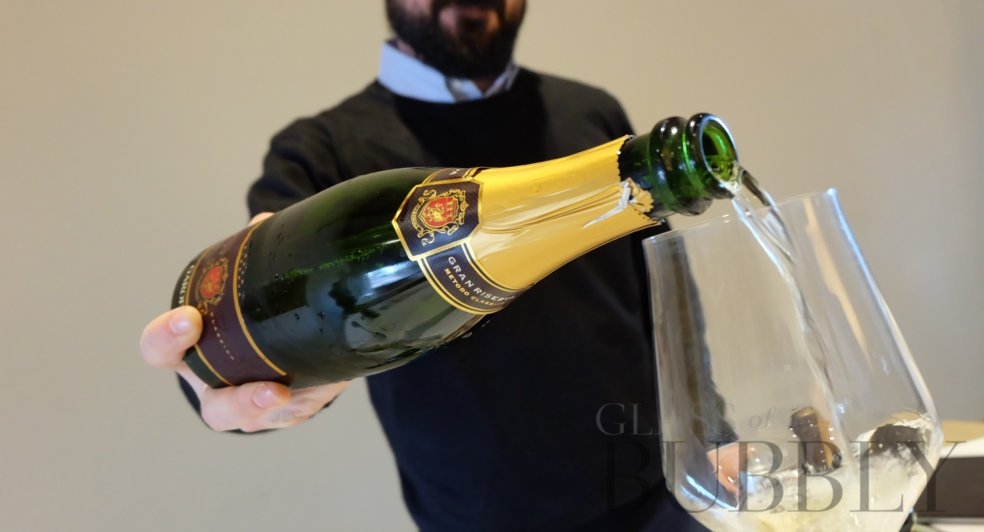 Pouring Le Marche sparkling wine.