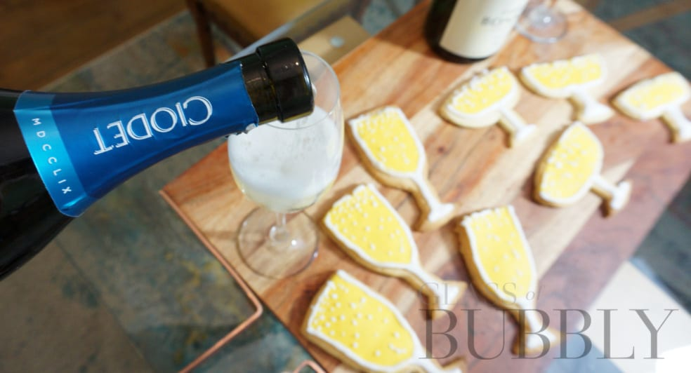 Pouring Prosecco to go with Prosecco Biscuits
