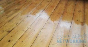 Adding second coat of varnish floor boards