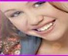 Vestir a Hannah Montana tocando la guitarra.
