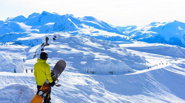 Snowboarder atop Whistler Mountain, BC