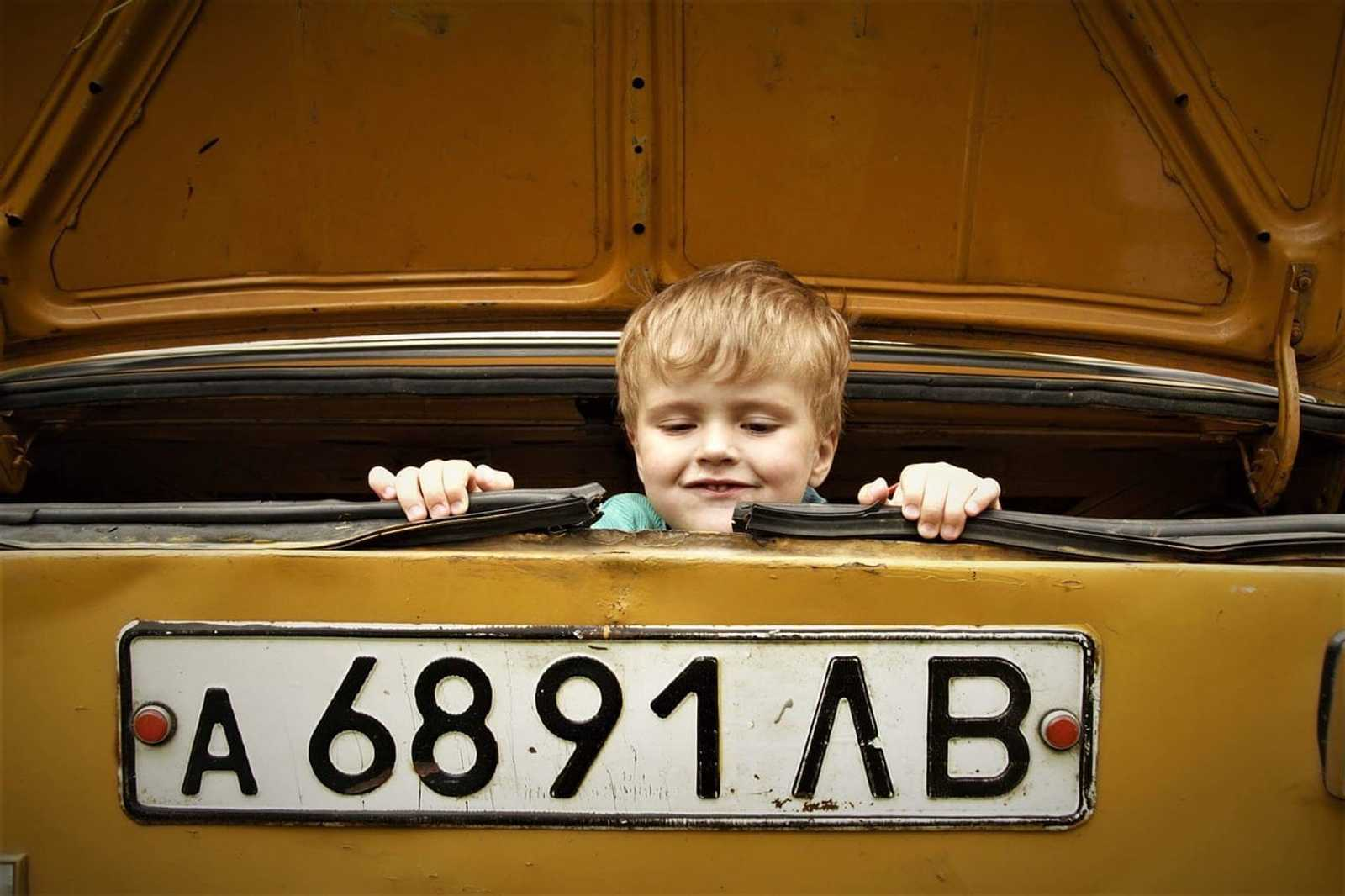child in trunk of car