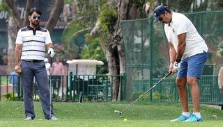 Ravi Shastri playing a round of golf with MS Dhoni