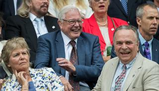 Legendary broadcaster David Attenborough shares a light moment during the Men's semifinals at the Centre Court