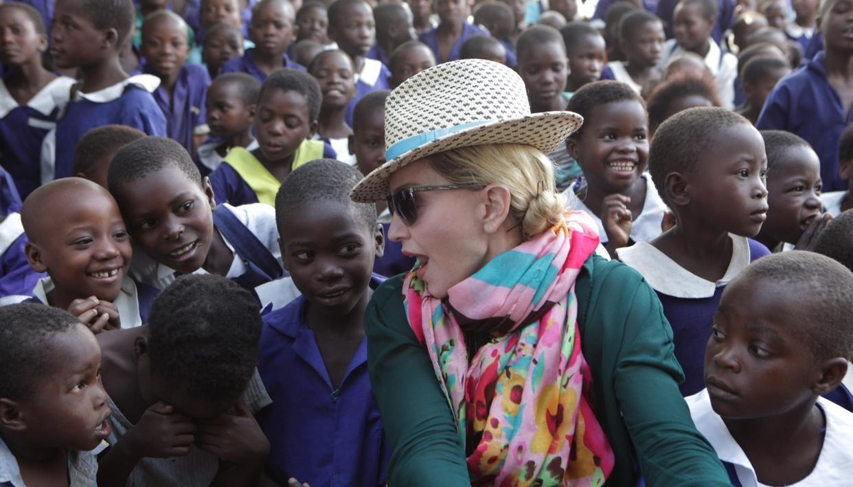Pop Star Madonna interacting with the school kids.