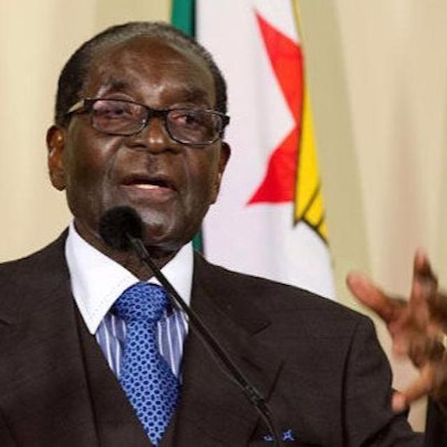 MUGABE HOLDS ON TIGHT