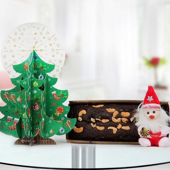 One Christmas tree shaped Archies Greeting Card, one 1/2 kg Plum Cake, a little cuddly Santa keyring