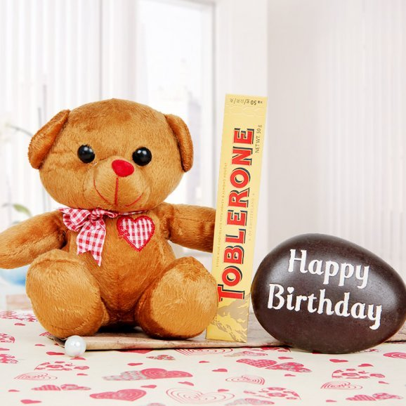 A 6 inches teddy with a toblerone and a birthday stone