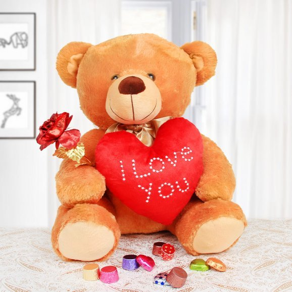 Teddy and artificial rose alongwith handmade chocolates