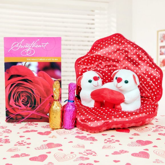 A greeting card with 2 handmade chocolates and a teddy