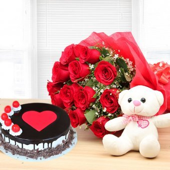 Deluxe Temptations - Combo of half kg Black Forest cake, 12 red roses and teddy