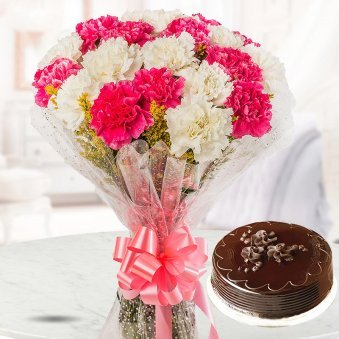 A mixed bunch of 10 pink and white carnations and a rich 1/2 kg Chocolate Truffle cake for Christmas