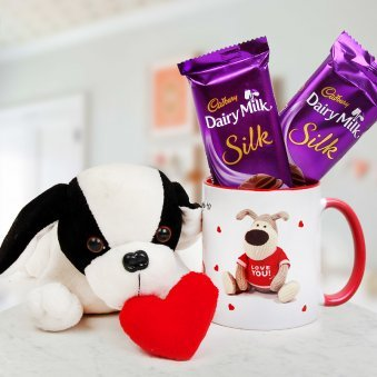 A Soft Toy Puppy with Heart A Coffee Mug and Two Dairy Milk Silk Chocolates