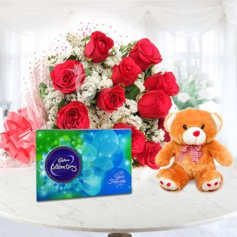 Made For You Combo - A gift hamper of 12 red roses with a teddy bear and Cadbury celebrations chocolates