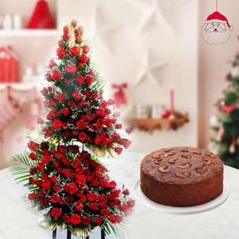array of 100 red beautiful roses with 1/2 kg rich and fluffy plum cake for Christmas