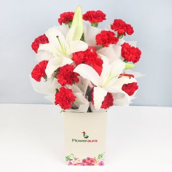 12 Red Carnations and 2 Lilies in Floweraura Box in Closed View