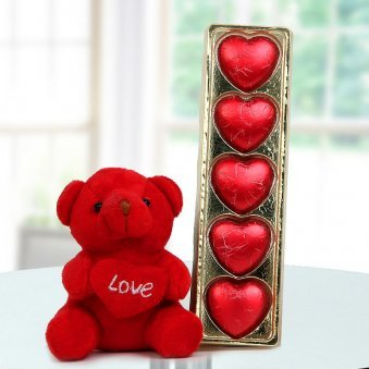 A tiny 3 inches teddy bear with a heart and a pack of heart shaped handmade chocolates