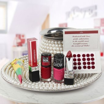 Pearl chain wrapped thali and kalash with bindi, mehndi, colorscense lip color and Maybelline nail paint