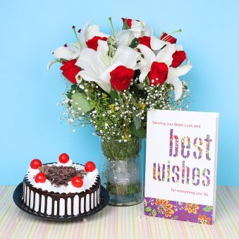 Mesmerizing Charm - A Diwali gift combo of mixed flowers, black forest Cake and a greeting card