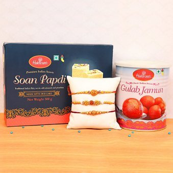Three Divine Rakhis Set with Soan Papdi and Gulab Jamun