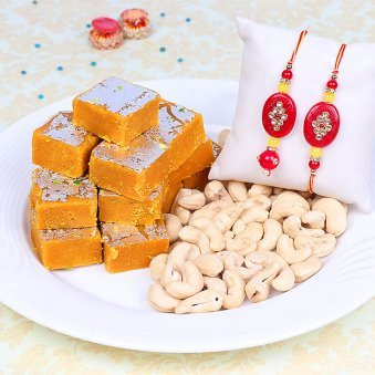 Set of Two Red Rakhis with 500gm Besan Barfi and 250gm Cashews