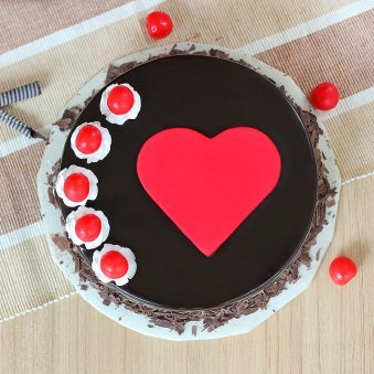 Black forest cake with fondant heart and cherries - Top View