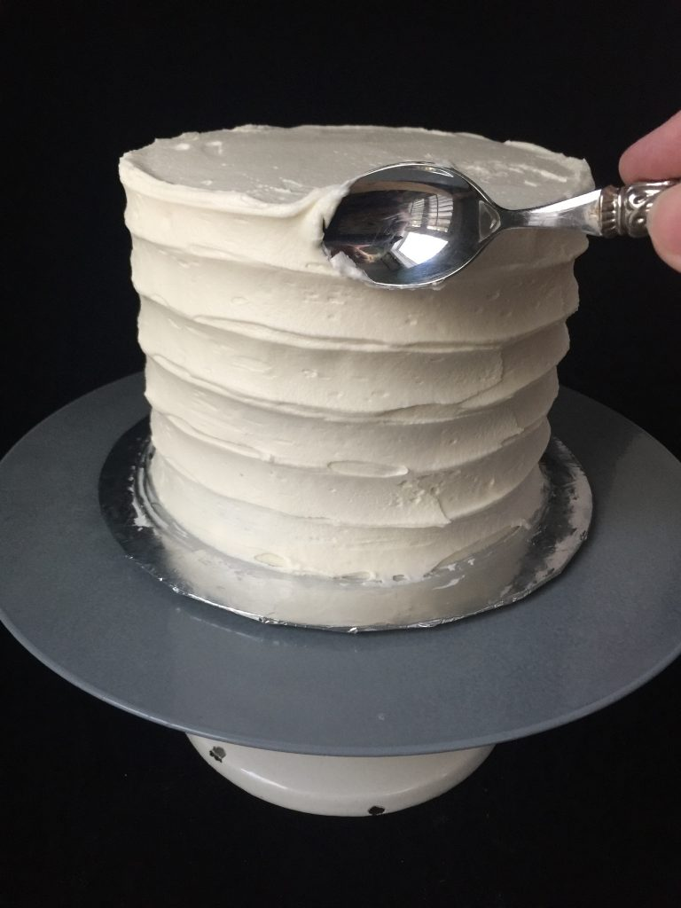 Cake getting rustic horizontal buttercream stripes