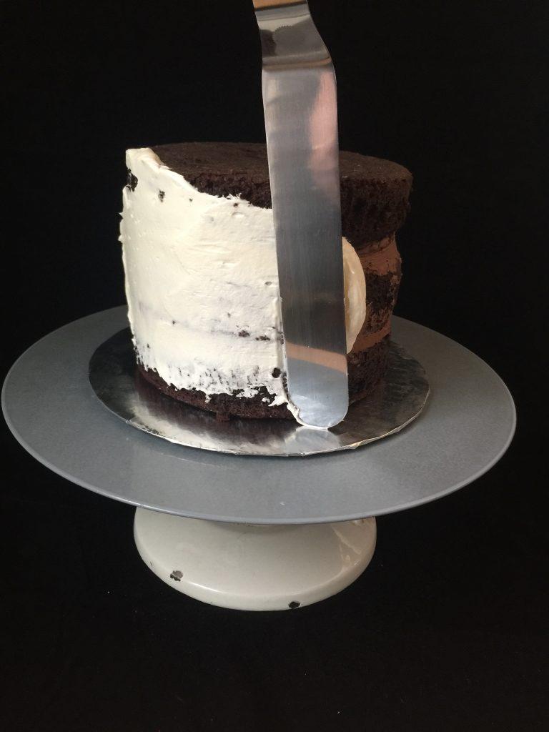 Chocolate cake getting a crumb coat