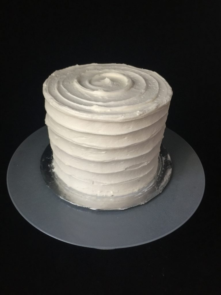 Cake with rustic horizontal buttercream stripes