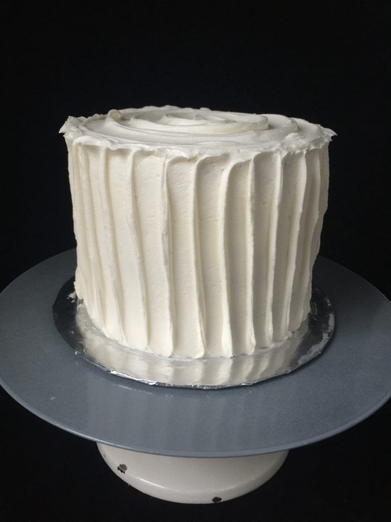 Cake with rustic vertical buttercream stripes